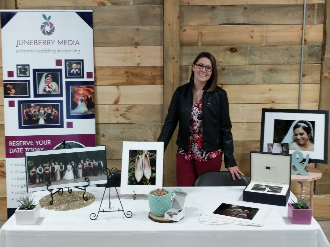 Me standing with my vendor booth at A Little Patch of Heaven bridal show.