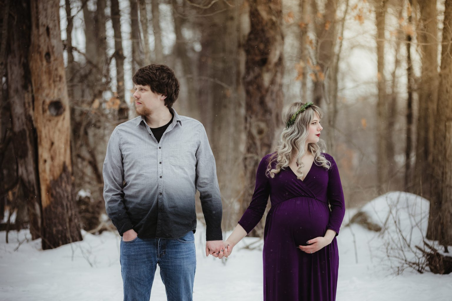 Winter maternity session with first-time parents and leaf crown.