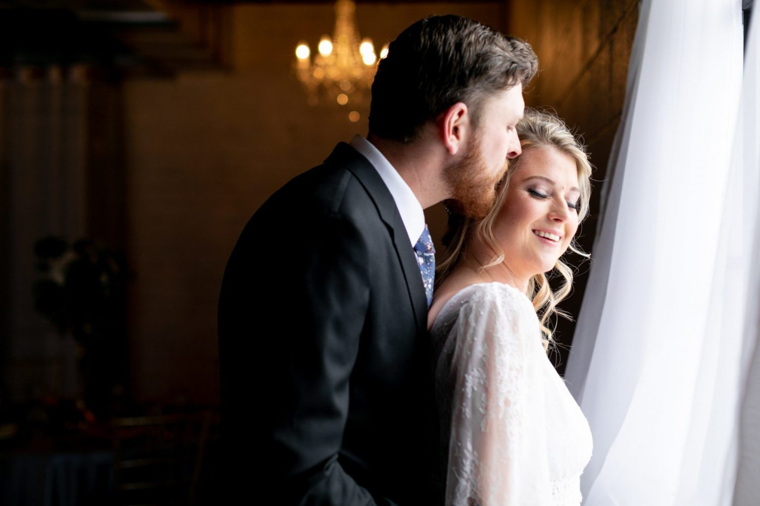 Beautiful window-lit couple at their Holly Vault wedding.