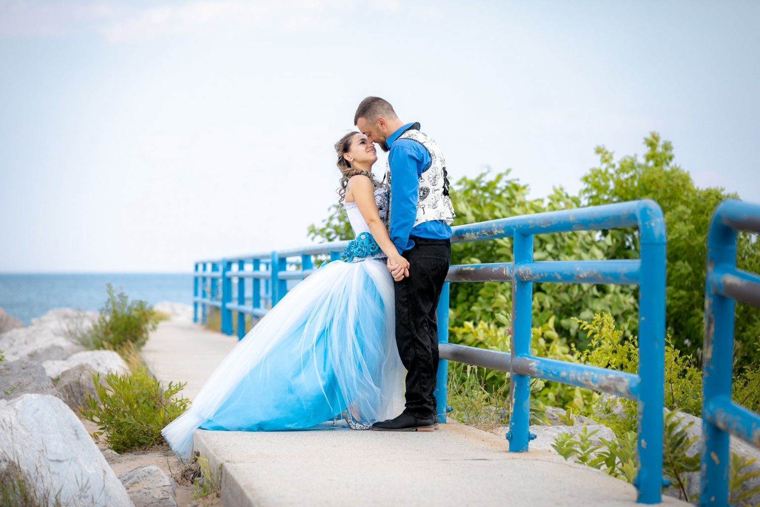 Lakeside wedding couple with an Alice in Wonderland themed wedding in Port Huron, MI.
